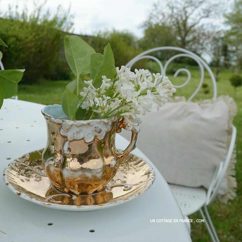 La tasse doree et le bouquet de lilas the golded cup and the lilas bouquet